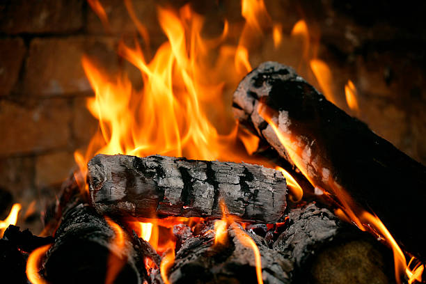 Real fire close-up Close-up of real fire in a fireplace. log fire stock pictures, royalty-free photos & images