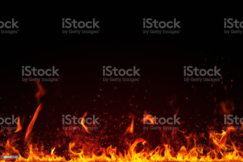 Real fire flames and sparks particles isolated on black stock photo