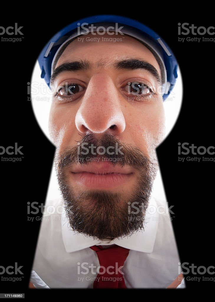 Real Handy Man try to see from the keyhole royalty-free stock photo