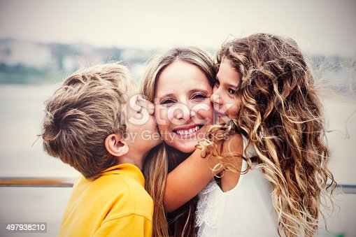 istock Real happy mother with her kids 497938210