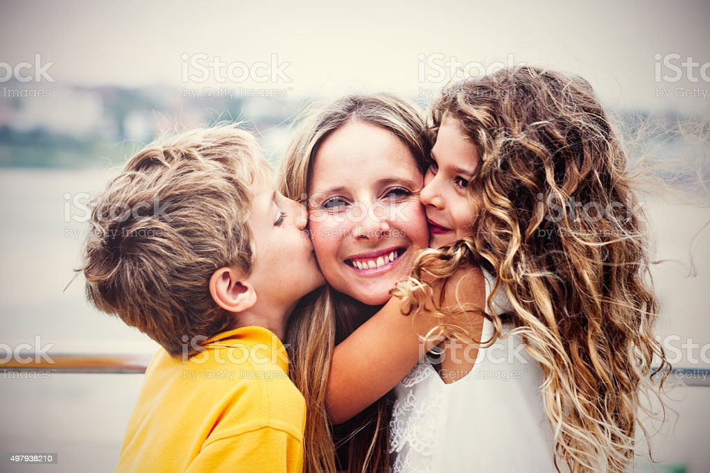 Real happy mother with her kids stock photo