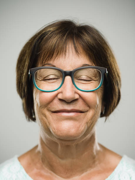 Real happy senior woman portrait with eyes closed stock photo