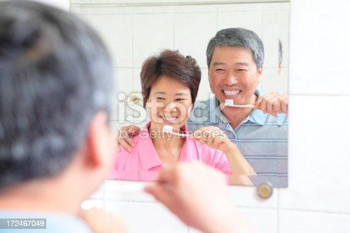 istock Real Happy seniors couple washing teeth 172467049