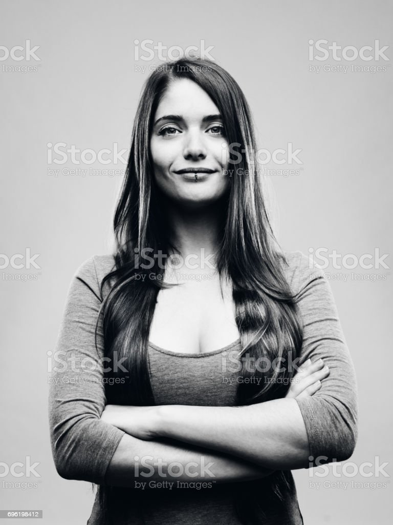 Real happy young woman studio portrait stock photo