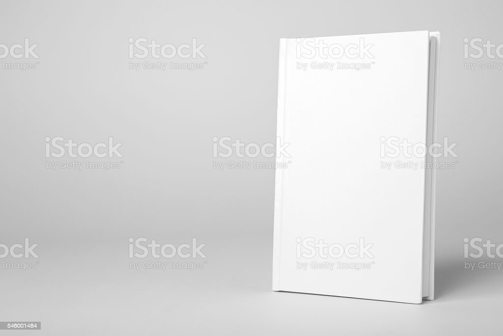 Real hardcover white book on a gray background foto