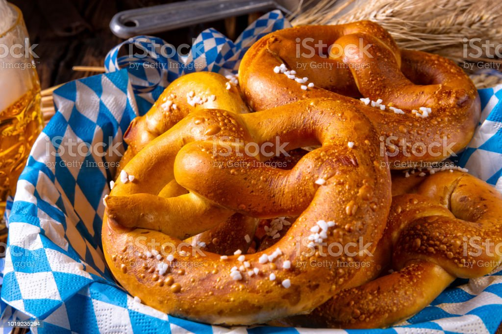 real homemade bavarian salty pretzel with beer stock photo