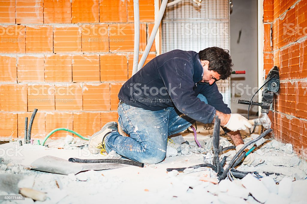 Real Italian builder at work stock photo