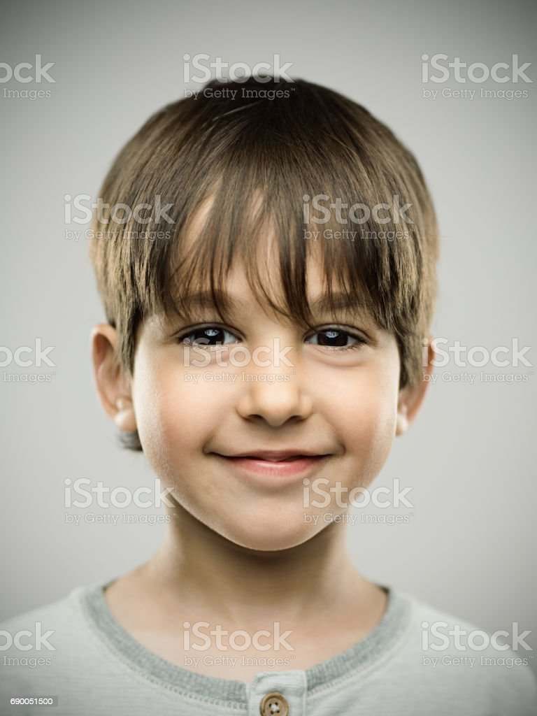Real kid with sweet smile stock photo