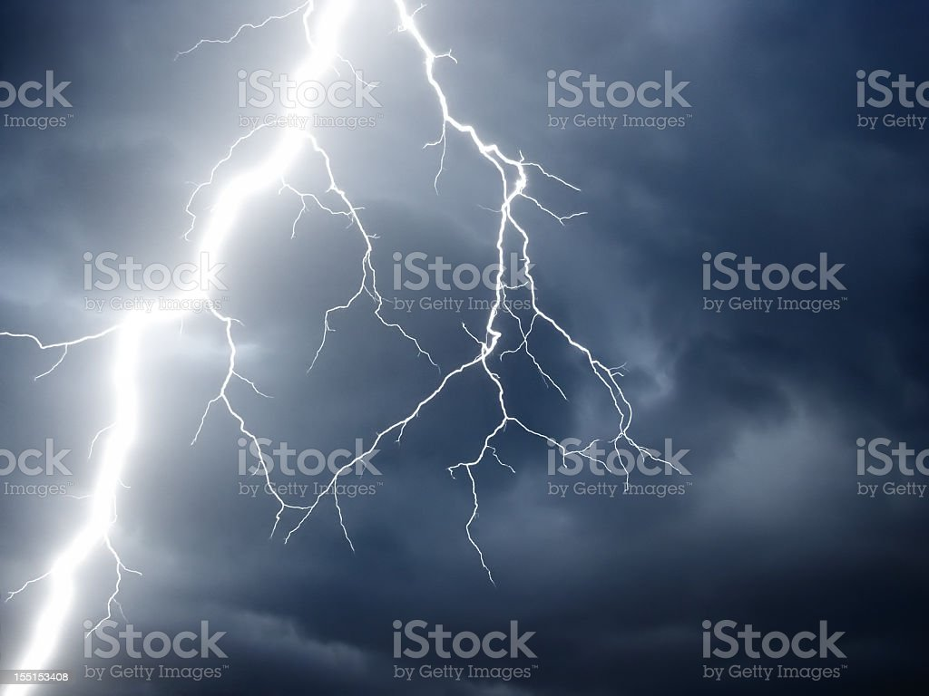 real lightning on stormy sky stock photo