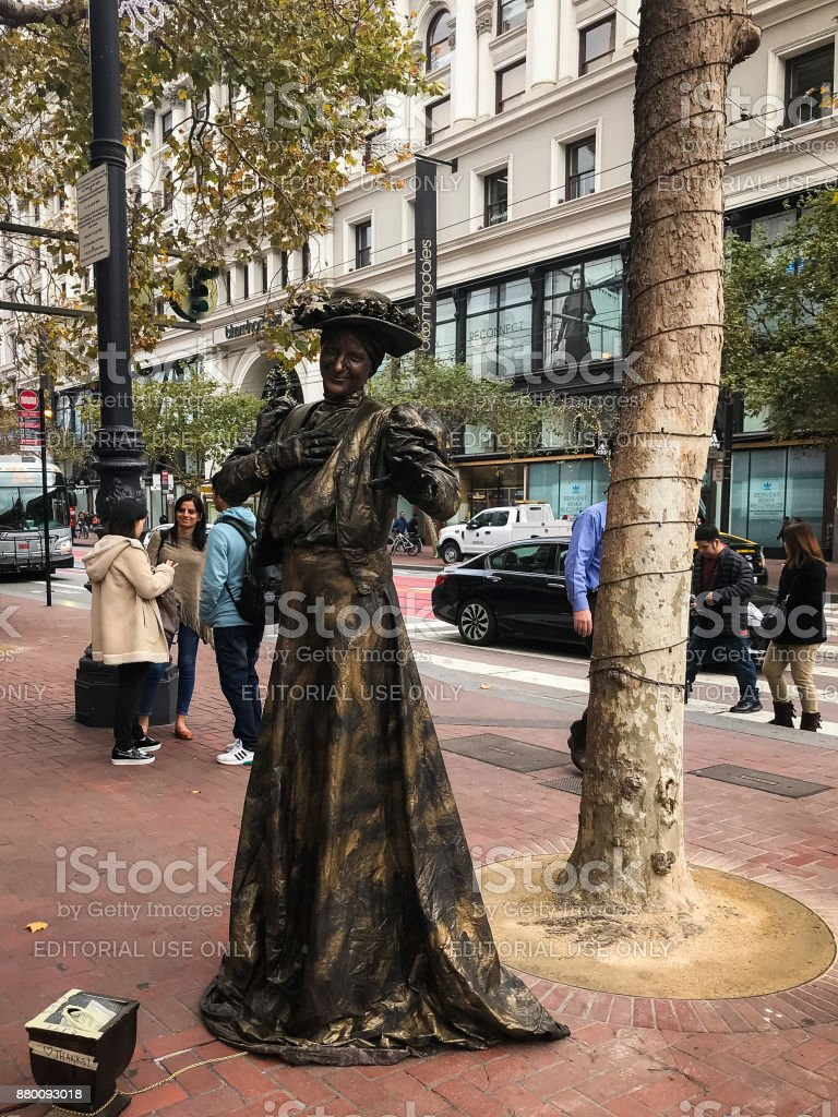 Real Live Bronzed Statue comes to Life stock photo