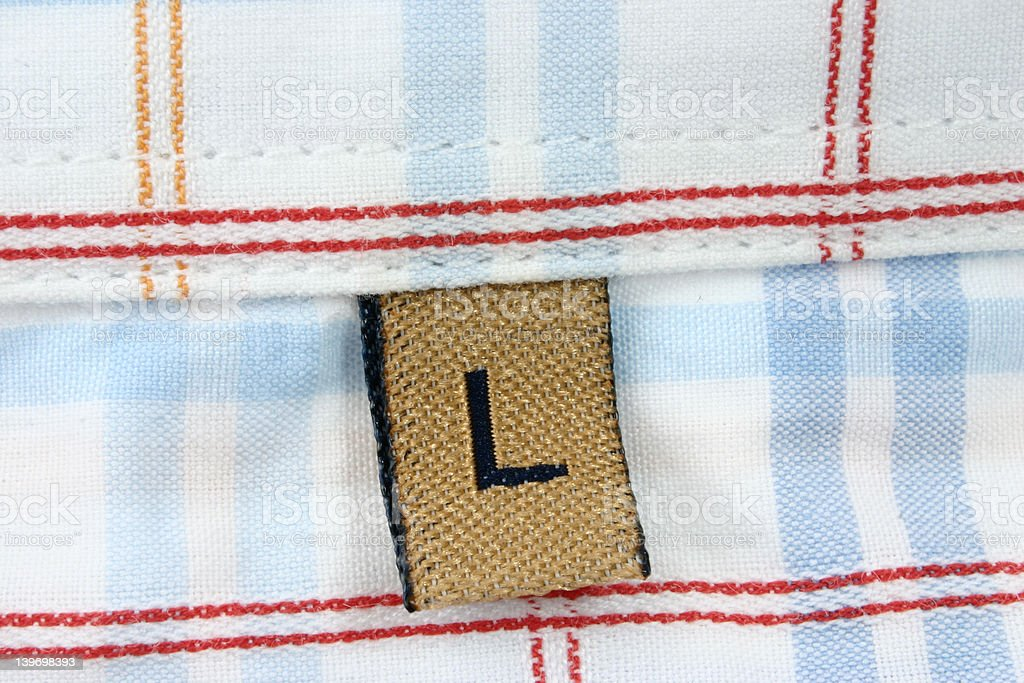 real macro of clothing label - SIZE L stock photo