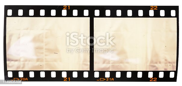1125303139 istock photo real macro photo of 35mm film strip or snip on white background 1149835468