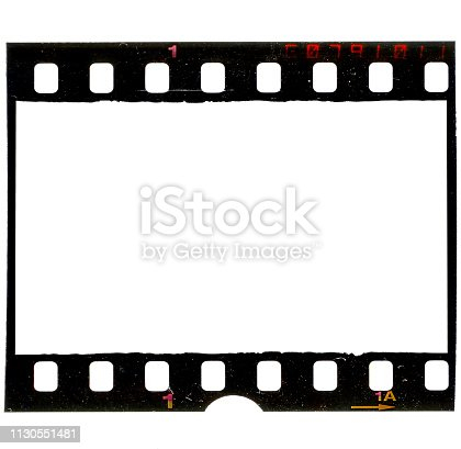1125303139 istock photo real macro photo of grungy looking 35mm filmstrip or film frame on white background 1130551481