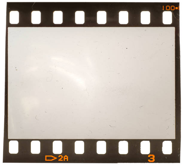 Real macro photo of old and grungy 35mm film frame or strip on white with signs of usage, dust and film grain Perfect placeholder for your image to let it look retro or vintage camera film stock pictures, royalty-free photos & images