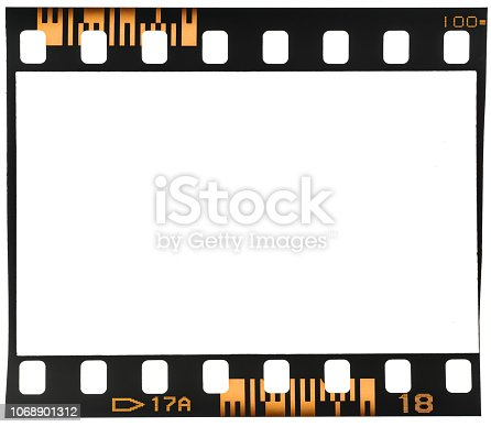 1129542015 istock photo Real macro photo of old and vintage looking 35mm film strip or dia frame on white 1068901312