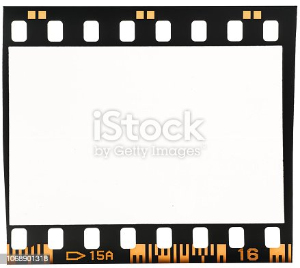 1129542015 istock photo Real macro photo of old and vintage looking 35mm film strip or dia frame on white 1068901318
