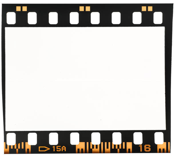 Real macro photo of old and vintage looking 35mm film strip or dia frame on white perfect placeholder for your image to let it look retro or old film negative stock pictures, royalty-free photos & images