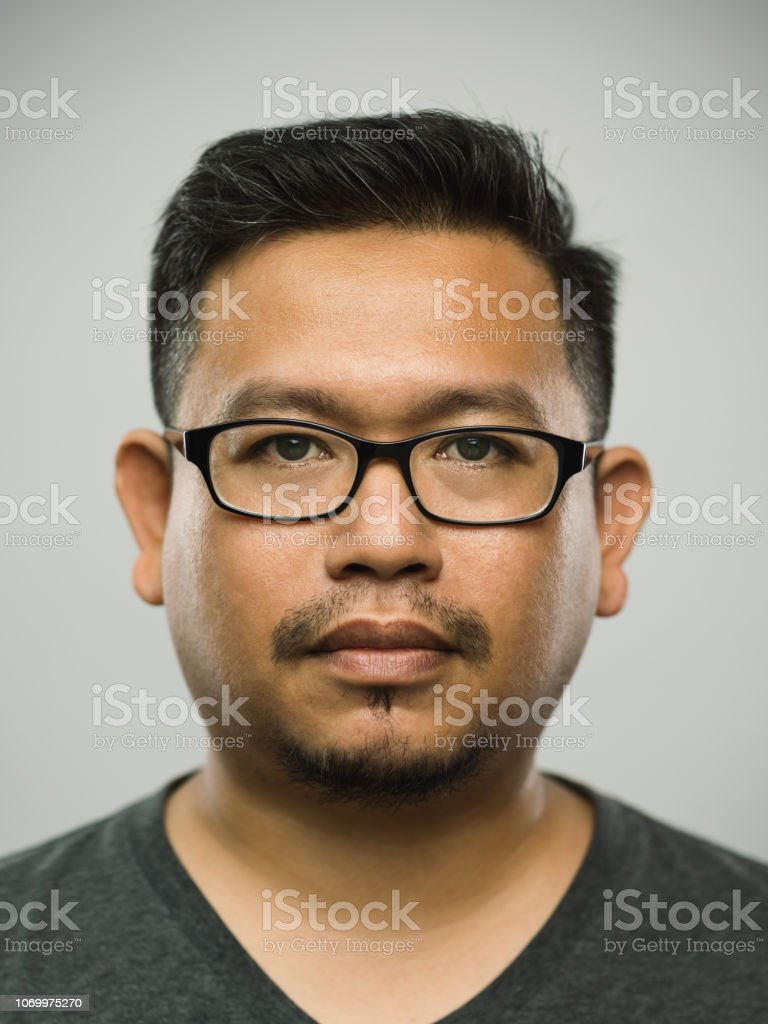 Real malaysian adult man with blank expression stock photo