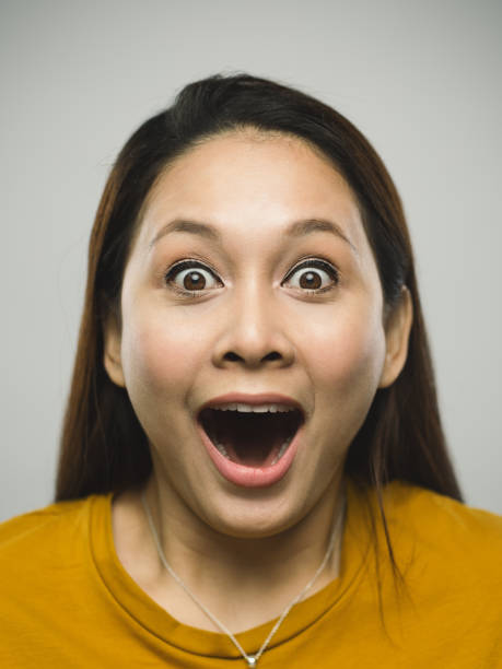 Real malaysian young woman with surprised expression stock photo