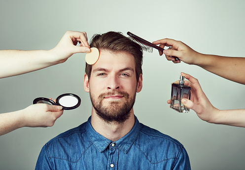 Real men get makeovers stock photo