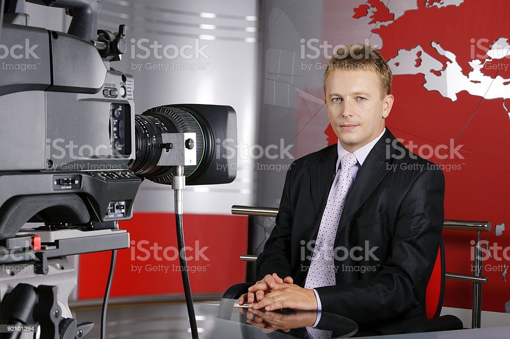 Real middle age television news presenter and camera stock photo