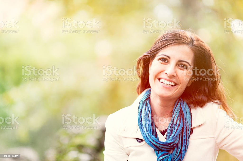Real middle age woman in the park stock photo