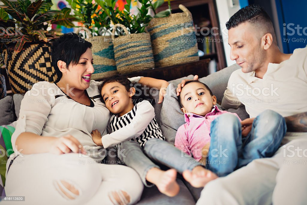 Real mixed race spouses of different religious with kids stock photo