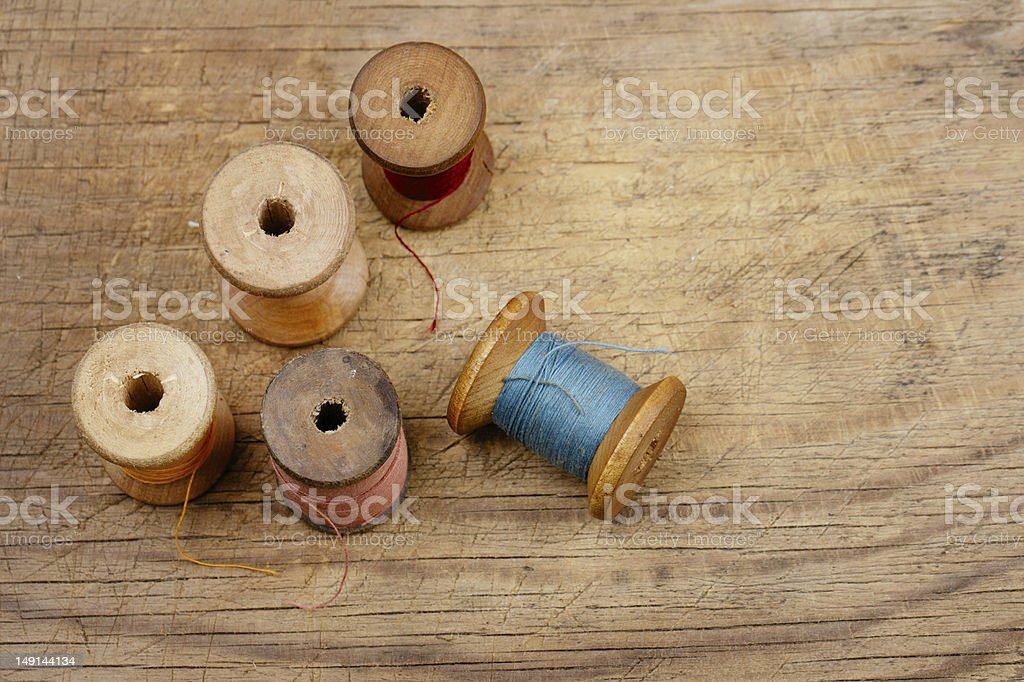 Real old spools with different colored threads royalty-free stock photo