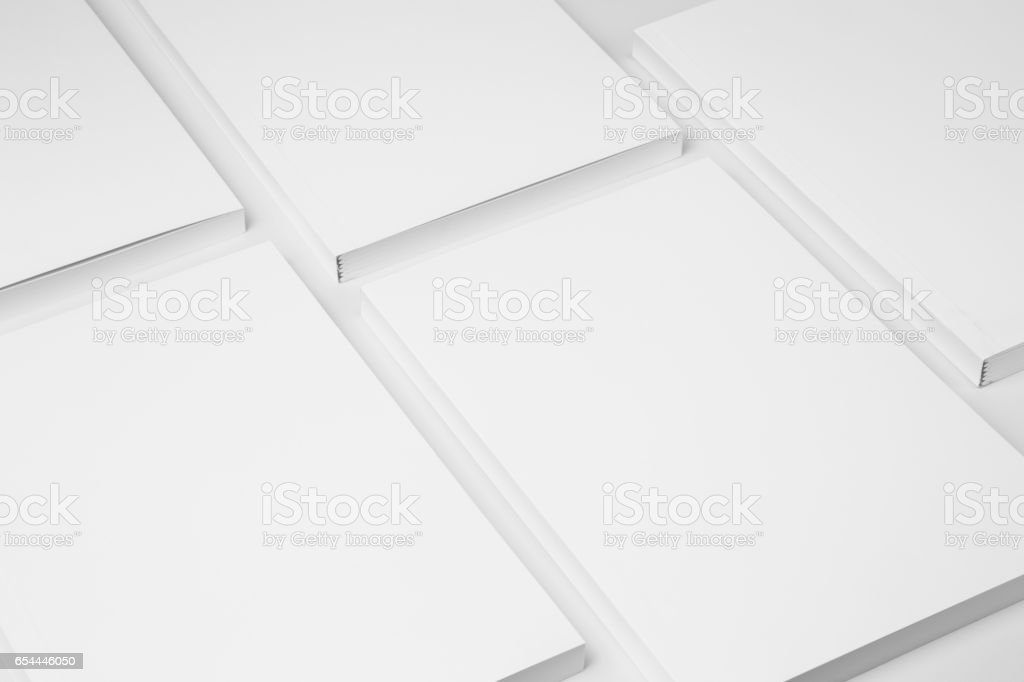 Real paperback white books on a gray background stock photo