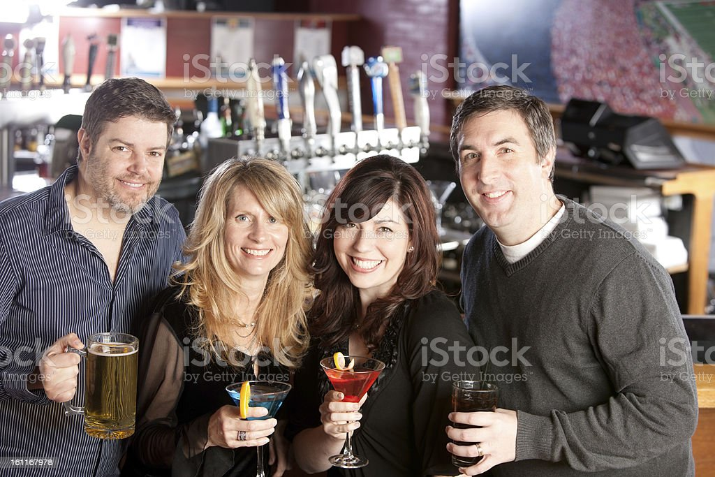 Real People: Adult Couples Friends Enjoy Bar Head Shoulders royalty-free stock photo