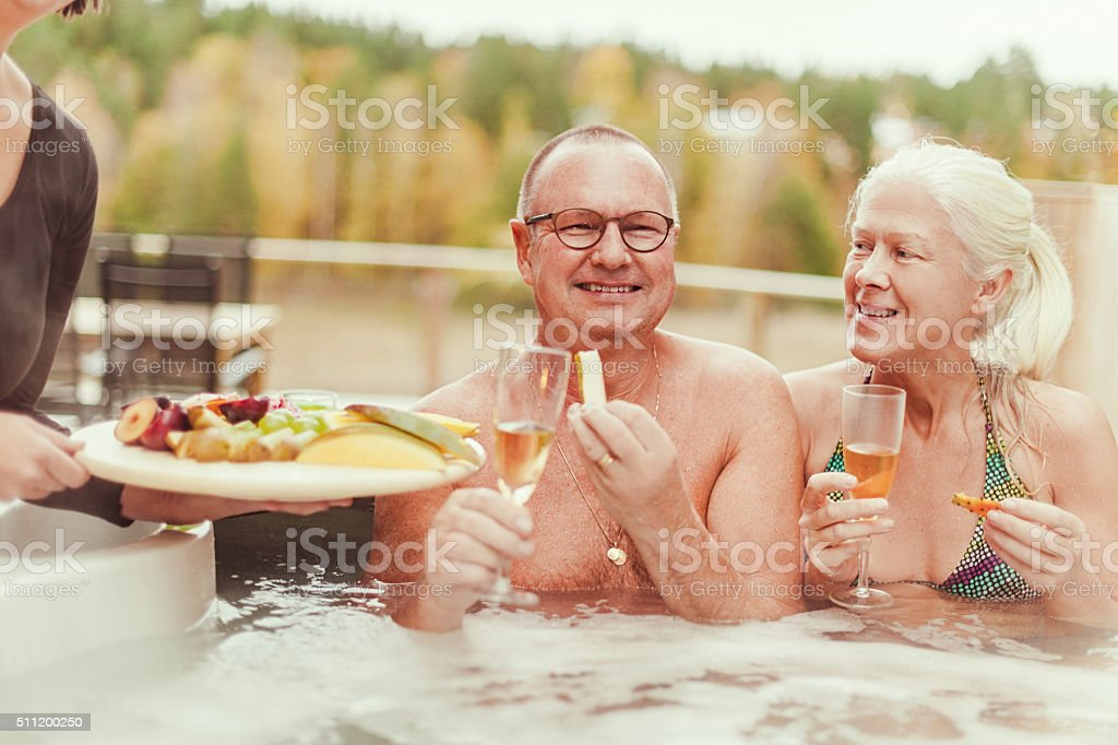 Real people at outdoors spa in tub stock photo