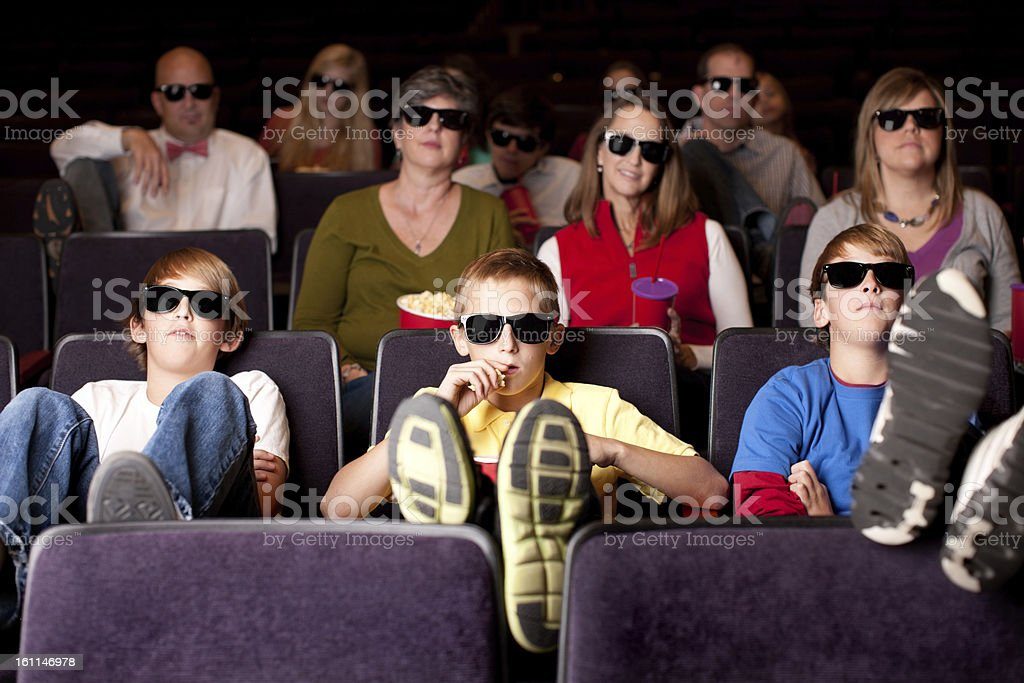 Real People Audience: Adults Teenagers Watching 3D Movie Theater royalty-free stock photo