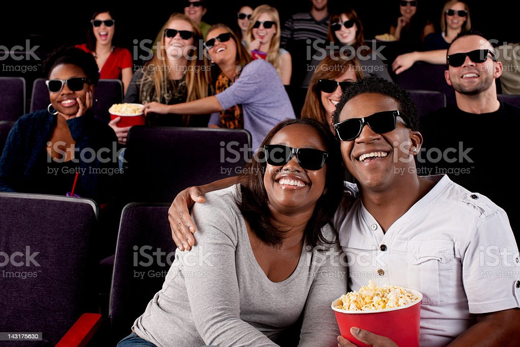 Real People Audience: Date Night Black Couple Watching Movie Theater stock photo
