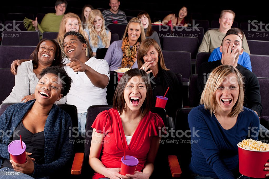 Real People Audience: Group Diverse Watching Movie Theater Comedy stock photo