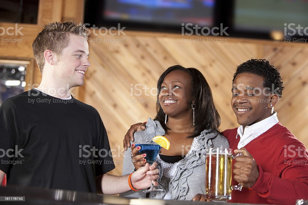 A head and shoulders image of a black young adult couple talking with...