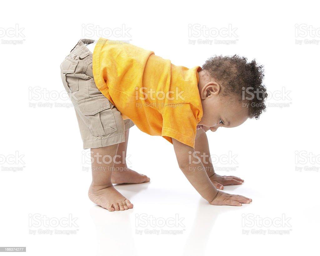 Real People: Black Toddler Boy Orange Bending Over Tumbling stock photo