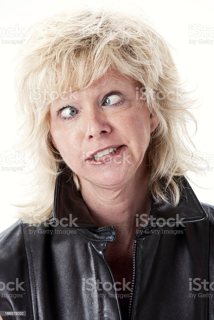 Real People: Caucasian Mid Adult Woman Cross Eyed Goofy Expression stock photo