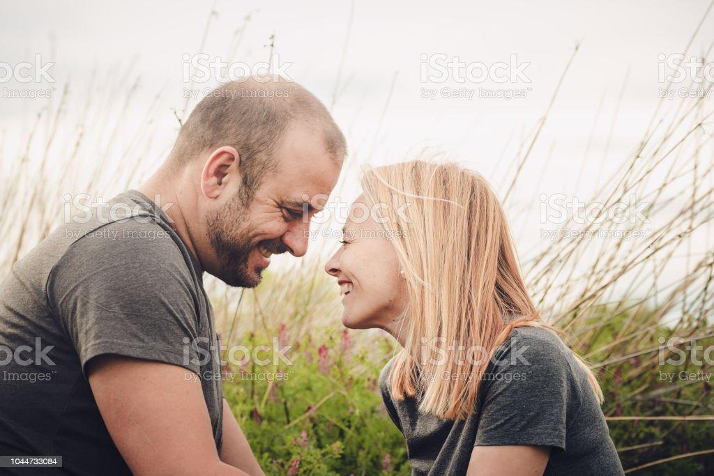 couple having fun in the field