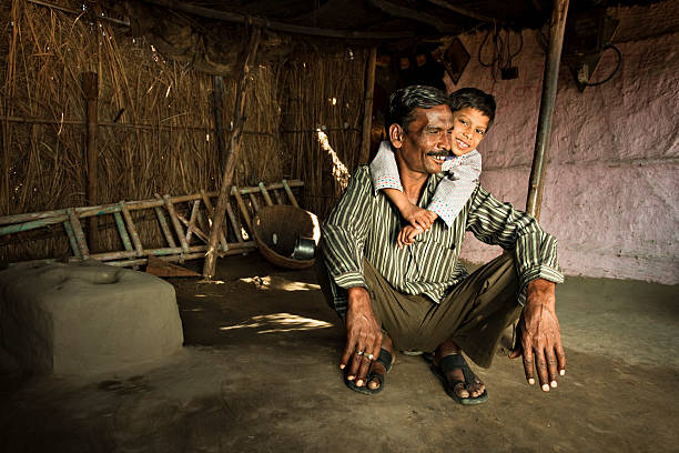 Real people from rural India: Happy father and son stock photo