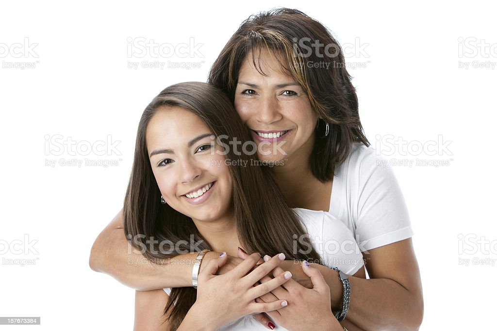 Real People: Head Shoulders Smiling Hispanic Mother and Teenage Daughter stock photo