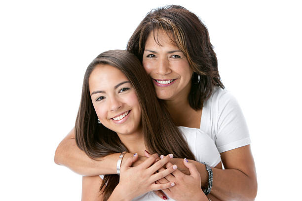 real people: head shoulders smiling hispanic mother and teenage daughter - daughter stock photos and pictures