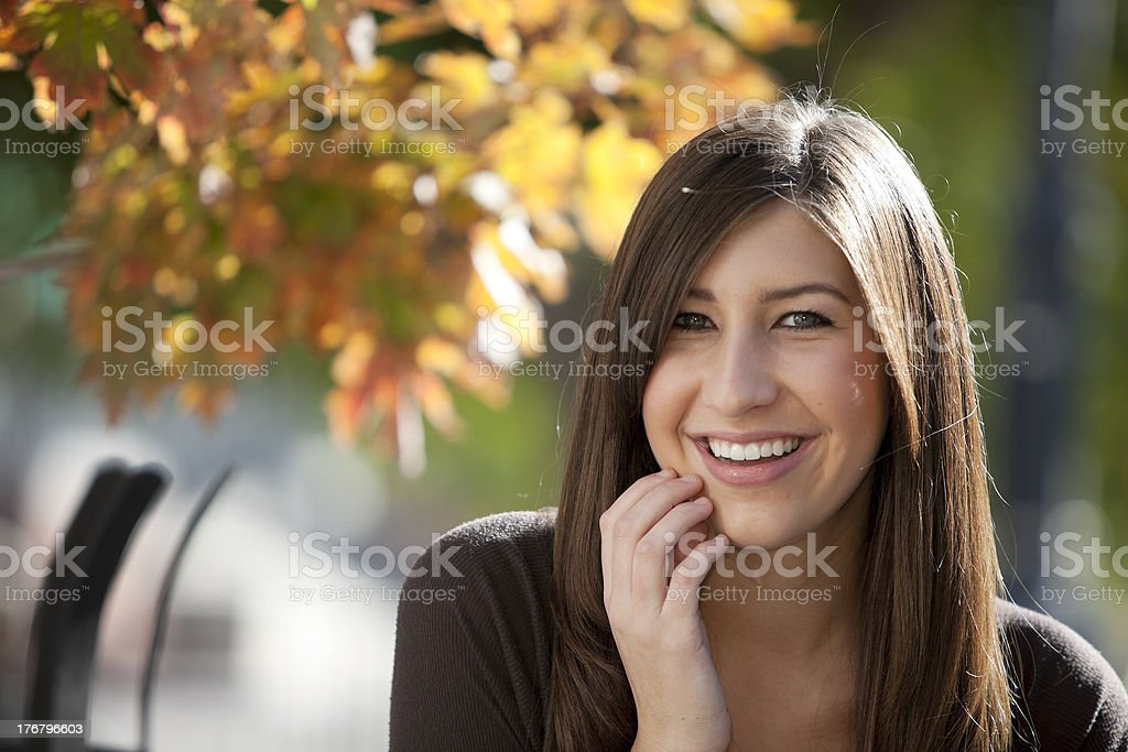 Real People: Head Shoulders Smiling Teenage Girl Outdoors Sunlight stock photo