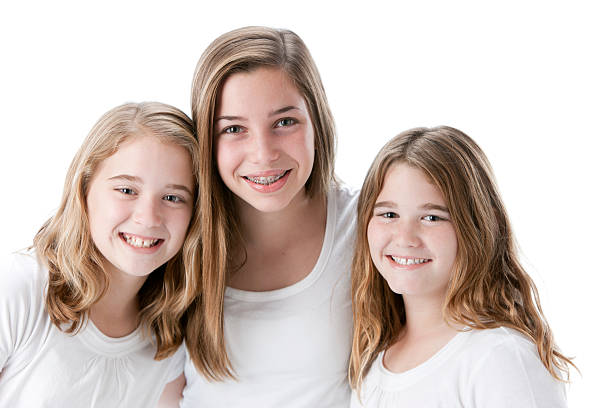 Real People: Head Shoulders Three Caucasian Smiling Sisters stock photo