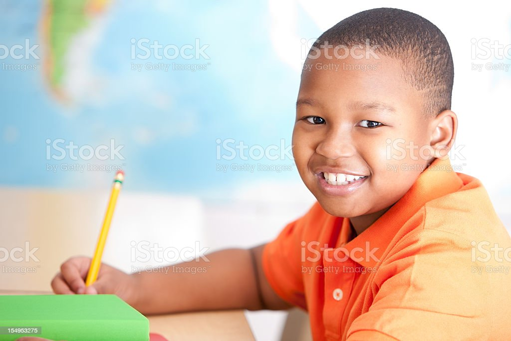 Real People: Little Boy African American Studying Learning in School royalty-free stock photo