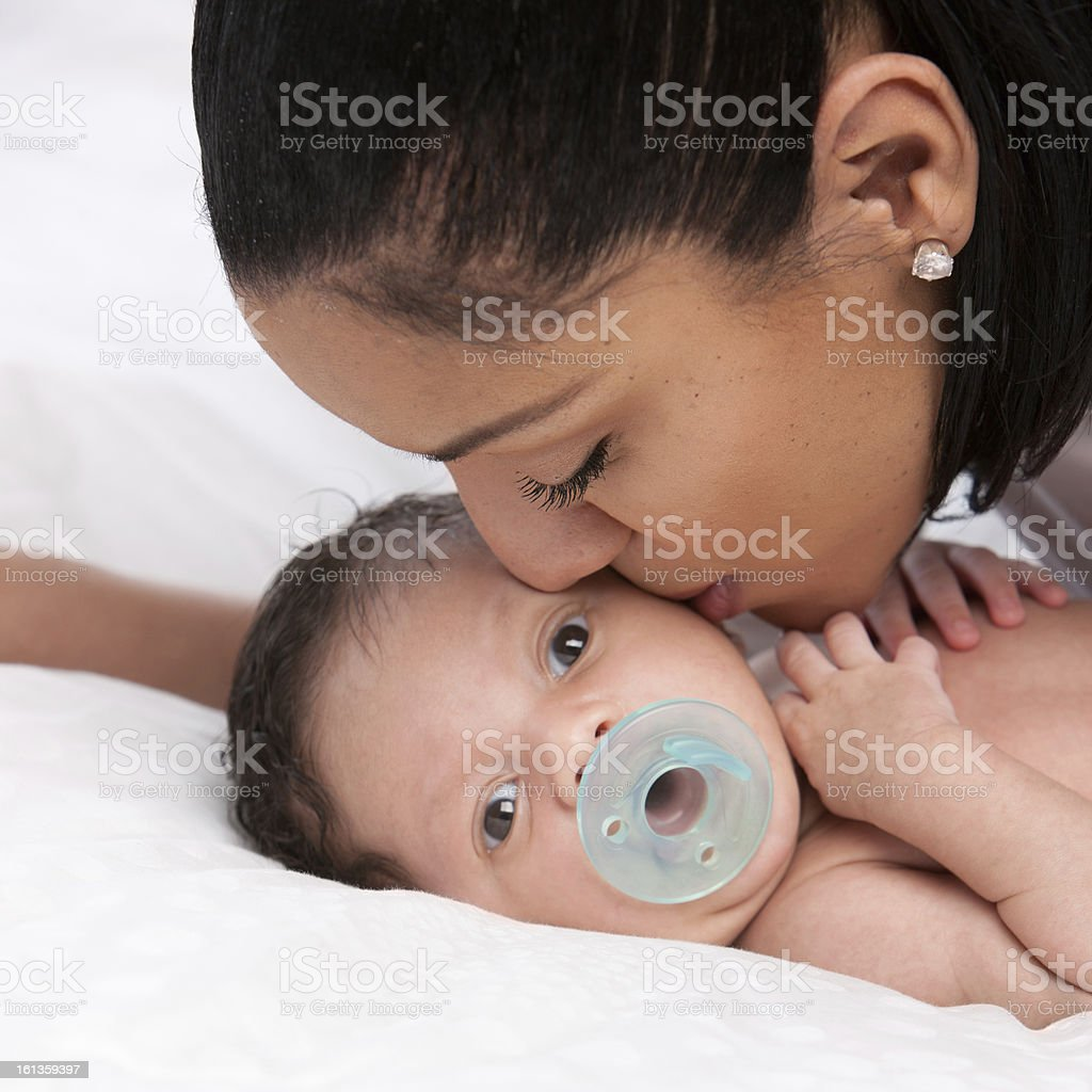 Real People: Mother Kissing Newborn Baby Boy African American royalty-free stock photo