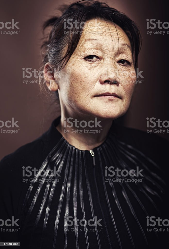 Portrait of a 60 year old asian female.