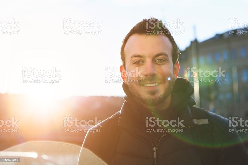 Young Man Smiling And Looking At Camera, Stockholm, Sweden