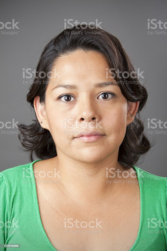 Real people portraits:  Native American woman on grey background royalty-free stock photo