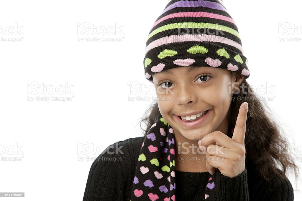 Real People:  Preteen Girl African American Pointing Finger Winter royalty-free stock photo