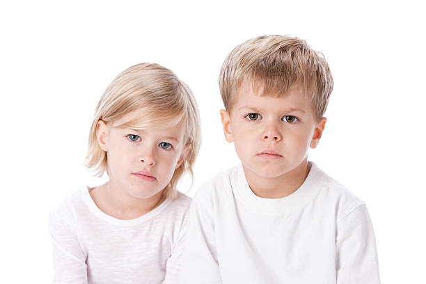 Real People: Serious Caucasian Twin Brother Sister Siblings Boy Girl stock photo